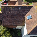 Aerial photograph of a residential home roof taken to assess damage