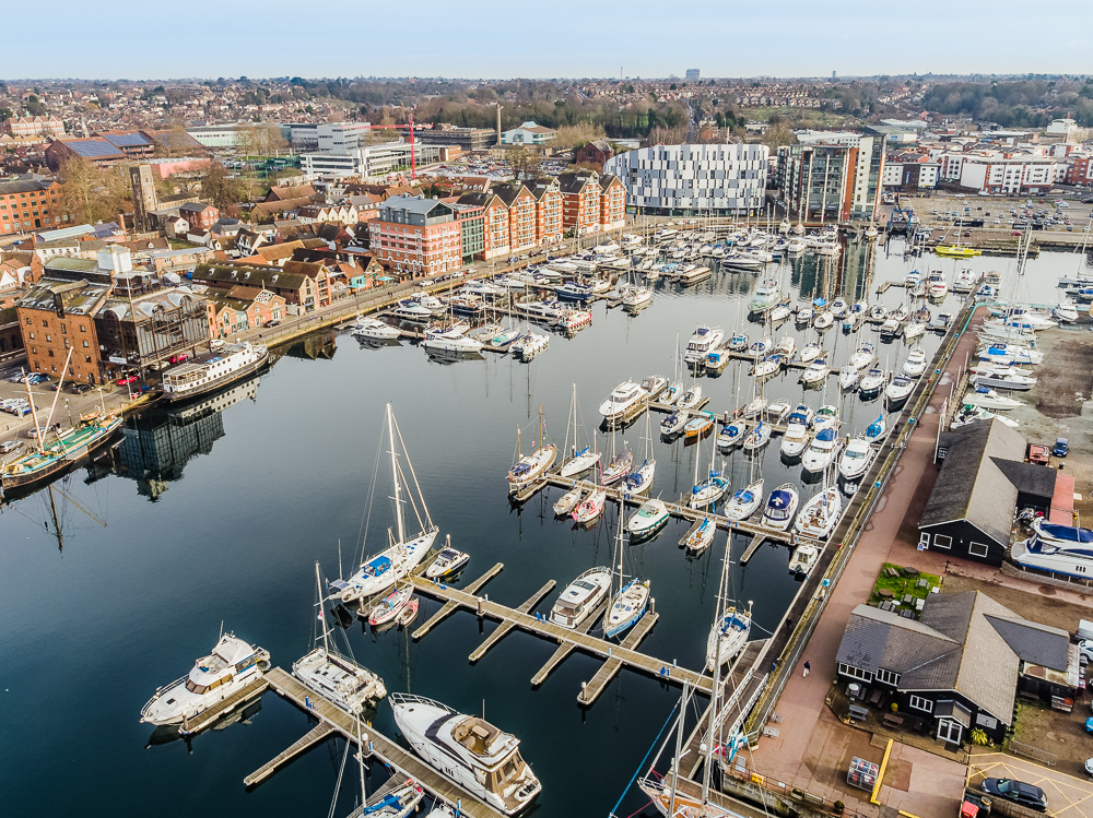 Aerial photograph of Ipswich waterfront showing customs house and the university of suffolk and the boats docked in the marina